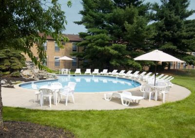 Swimming pool with sun deck and free poolside Wi-Fi for residents at Willow Shores.